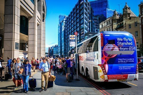People getting out of the National Express Bus in London.